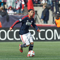 New England Revolution midfielder Lee Nguyen (24) brings the ball forward.  In a Major League Soccer (MLS) match, the New England Revolution (blue/white) tied Vancouver Whitecaps FC (white), 0-0, at Gillette Stadium on March 22, 2014.