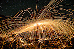 Fire spinning at the Bombo Quarry in Kiama Downs in NSW Australia