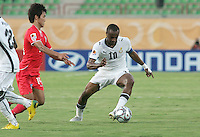 Ghana's Andre Ayew (10) keeps control of the ball against South Korea's Ki Han Moon (14) during the FIFA Under 20 World Cup Quarter-final match between Ghana and South Korea at the Mubarak Stadium  in Suez, Egypt, on October 09, 2009.