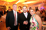 """Southington, CT- 04 February 2017-020417CM16-  Social Moments--- From left, Charlie Beale of Tampa FL, Kyle Jurczyk, Chief of Accounting at St, Mary's Hospital with his wife Shannon Jurczyk are photographed during the """"A Night in Havana"""" the 26th annual Gala put on by Saint Mary's Hospital Aqua Turf in Southington.   Christopher Massa Republican-American"""