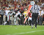 Alabama running back Eddie Lacy (42) is tackled by Ole Miss defensive back Charles Sawyer (3) at Bryant-Denny Stadium in Tuscaloosa, Ala. on Saturday, September 29, 2012.
