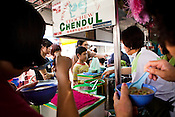 Customers gather to eat chendol at Penang's famous Teo Chew Chendol cart in Georgetown of Penang, Malaysia. Photo: Sanjit Das/Panos
