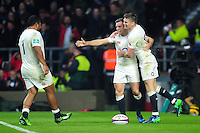 George Ford of England celebrates scoring a try with team-mates Owen Farrell and Mako Vunipola. Old Mutual Wealth Series International match between England and South Africa on November 12, 2016 at Twickenham Stadium in London, England. Photo by: Patrick Khachfe / Onside Images