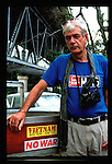 Conflict photographer Tim Page stands by his truck outside his home in Brisbane, Australia, 2004..Photographer: Robert Gilhooly