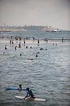 ISRAEL Tel Aviv<br /> Surfers at the sea.