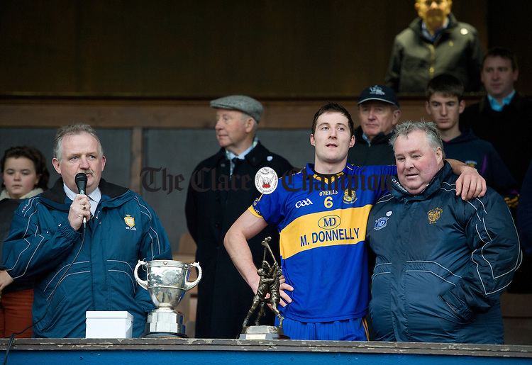 Clare GAA chairman Michael O Neill speaks as Newmarket captain Enda Barrett embraces fellow clubman Christy Ryan following the senior county hurling final at Cusack Park. Photograph by John Kelly.