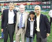 Owner Will Chang of D.C. United with club president Kevin Payne and Sunil Galati of US Soccer with his son during an MLS match against the New England Revolution on April 3 2010, at RFK Stadium in Washington D.C.