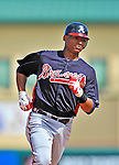 13 March 2012: Atlanta Braves catcher Christian Bethancourt rounds the cases after hitting a solo home run in the 9th inning to tie the score at two, during a Spring Training game against the Miami Marlins at Roger Dean Stadium in Jupiter, Florida. The two teams battled to a 2-2 tie playing 10 innings of Grapefruit League action. Mandatory Credit: Ed Wolfstein Photo