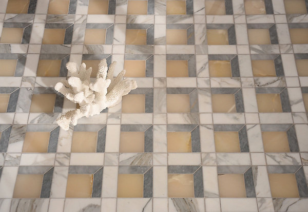 Paseo, a handmade mosaic shown in polished Cream Onyx, honed Allure, and honed Calacatta Tia, is part of the Illusions™ Collection by Sara Baldwin Designs and Paul Schatz for New Ravenna.