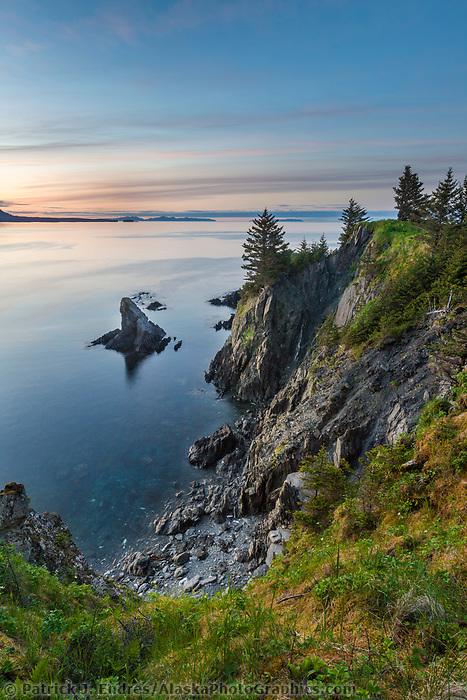 Sunset off the shores of Fort Ambercrombie state park, Kodiak Island, Alaska.