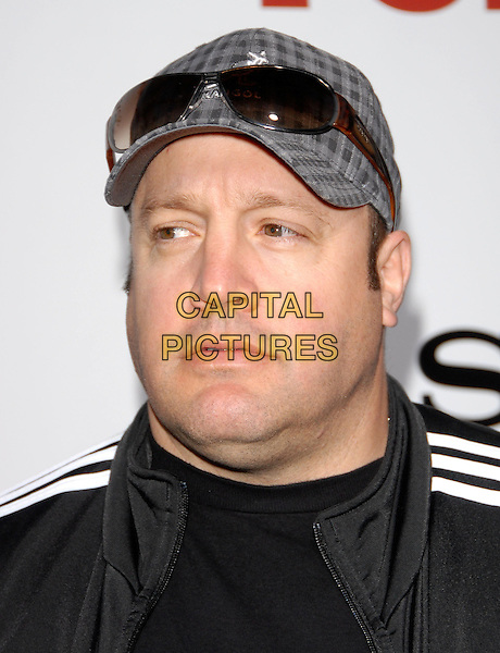 "KEVIN JAMES .At the Screen Gems World Premiere of ""Death at a Funeral"" held at The Cinerama Dome in Hollywood, California, USA, April 12th 2010..portrait headshot cap hat sunglasses black .CAP/RKE/DVS.©DVS/RockinExposures/Capital Pictures."