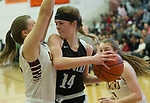 Chugiak's Eva Palmer runs into Dimond's Megan Luther during the CIC championship loss to the Lynx.  Photo for the Star by Michael Dinneen