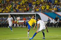 Miami, FL - Saturday, Nov 16, 2013: Brazil vs Honduras during an international friendly at Miami's Sun Life Stadium. Brazilian Robinho controls the ball while defender Juan Pablo watches it.