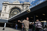 Young refugees play soccer at the makeshift refugee camp at the Budapest Keleti railway station.<br /> <br /> Hundreds of refugees from mostly Syria and Afghanistan gather at the Budapest Keleti railway station waiting for trains to leave for destinations such as Austria, Germany and Sweden, in Budapest, Hungary, on Tuesday, Sept. 8, 2015. Hungary's Prime Minister Viktor Orban created an anti-refugee campaign to generate hate against those fleeing war in their home countries. The country is currently 50% xenophobic and the government has become increasingly authoritarian.