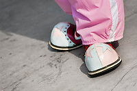A clown wears oversized pink shoes during the Clown Congress in San Salvador, El Salvador, 18 May 2011. The clown performance is considered a regular job in most of Latin American countries. Clowns may work individually or in groups, often performing advertisement like acts in large open-to-street shops or they take part in private shows, like children birthdays, family events etc. There are many clown conventions all over Latin America where clowns gather and exchange their experiences offering workshops of the comic acting or the art of make-up. For some of them, being clown is a serious lifetime profession.