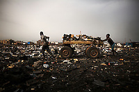Children push a cart loaded with scrap, including computers keyboards and other e-waste, at Agbogbloshie dump, Accra, Ghana.