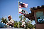 State Park Superintendent Kelly Claar, left, advises visitors that much of Brannan Island State Recreation Area is closed near Rio Vista, Calif., June 13, 2012. Brannan Island is one of ten state parks to be taken over by a private concession in an effort to prevent mass park closures. CREDIT: Max Whittaker/Prime for The Wall Street Journal.CALPARKS.