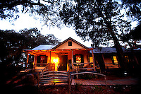 LITTLE ST. SIMONS ISLAND, FL -- October 2, 2010 -- The Hunting Lodge is lit at sunrise on Little St. Simons Island on Saturday, October 2, 2010.   The 10,000 acres of marshland, beaches, and forests are a refuge for wildlife and vacationers alike with only 32 guests permitted a night.  (Chip Litherland for Bay Magazine)