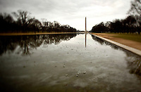 The Washington monument is reflected in the reflecting pool on a dreary day in Washington, DC. The Washington Monument is the most prominent structure, as well as one of the earlier attractions, in Washington, D.C. It was built in honor of George Washington, who led the country to independence and then became its first President. The Monument is shaped like an Egyptian obelisk, stands 555? 5 1/8? tall, and offers views in excess of thirty miles. It was finished on December 6, 1884.
