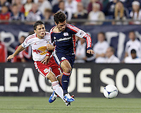 New York Red Bulls defender Connor Lade (16) fouls New England Revolution substitute midfielder Benny Feilhaber (22). Connor Lade received a second yellow card, a red card ejection. Despite a red-card man advantage, in a Major League Soccer (MLS) match, the New England Revolution tied New York Red Bulls, 1-1, at Gillette Stadium on September 22, 2012.