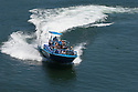 Jetboat ride with the Mail Boat tour company on the Rogue River; Gold Beach, Oregon Coast..