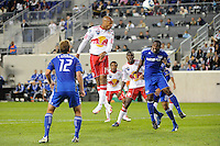 Thierry Henry (14) of the New York Red Bulls heads the ball towards goal during a Major League Soccer (MLS) match against the Kansas City Wizards at Red Bull Arena in Harrison, NJ, on October 02, 2010.