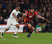 Swansea City's Jordan Ayew (L) battles with Bournemouth's Charlie Daniels (R)<br /> <br /> Bournemouth 2 - 0 Swansea<br /> <br /> Photographer David Horton/CameraSport<br /> <br /> The Premier League - Bournemouth v Swansea City - Saturday 18th March 2017 - Vitality Stadium - Bournemouth<br /> <br /> World Copyright &copy; 2017 CameraSport. All rights reserved. 43 Linden Ave. Countesthorpe. Leicester. England. LE8 5PG - Tel: +44 (0) 116 277 4147 - admin@camerasport.com - www.camerasport.com