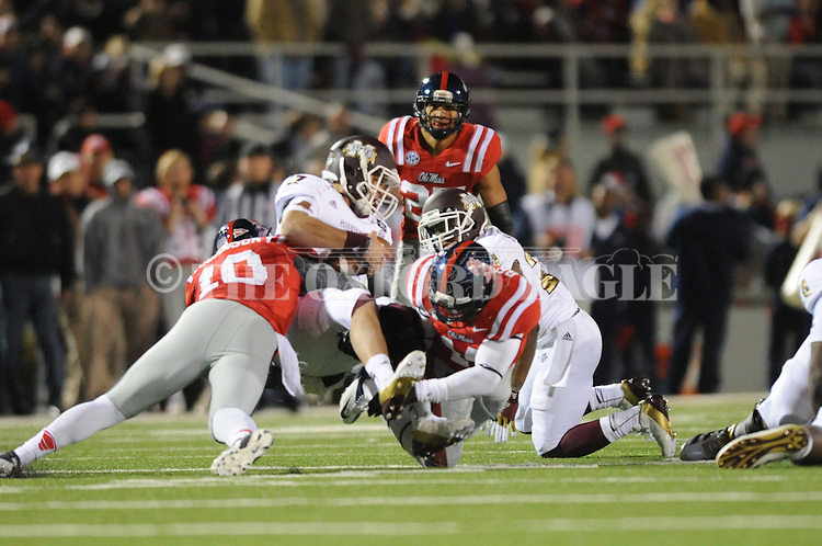 Ole Miss defensive end C.J. Johnson (10) and Ole Miss linebacker Serderius Bryant (14) sack Mississippi State quarterback Tyler Russell (17) at Vaught Hemingway Stadium in Oxford, Miss. on Saturday, November 24, 2012. Ole Miss won 41-24.