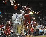 "Ole Miss guard Chris Warren (12)  shoots as Arkansas' Delvon Johnson (21) and Arkansas' Julysses Nobles (23) defend at C.M. ""Tad"" Smith in Oxford, Miss. on Saturday, March 5, 2010. Ole Miss won 84-74."