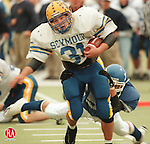 WEST HAVEN,CT. 12/5/98--1205SV09.tif--#31 Matt Syombathy of Seymour drives for yardage as #5 Brian Chacos of Darien trys to pull him down during the CIAC Class M State Football Championship in West Haven on Saturday. Seymour Won. Steven Valenti Photo for Jaffey story.
