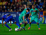 FC Barcelona's Lionel Messi (C) in action during the spanish league football match Levante UD vs FC Barcelona on April 14, 2012 at the Ciudad de Valencia Stadium in Valencia. (Photo by Xaume Olleros/Action Plus)