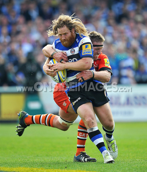 Ross Batty of Bath Rugby is tackled by Brad Thorn of Leicester Tigers. Aviva Premiership semi-final, between Bath Rugby and Leicester Tigers on May 23, 2015 at the Recreation Ground in Bath, England. Photo by: Patrick Khachfe / Onside Images