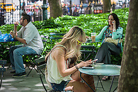 A visitor to Bryant Park in New York uses her tablet computer on Tuesday, June 4, 2013.  (© Richard B. Levine)