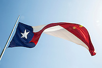 A huge majestic Texas state flag proudly waving in the wind - stock image.