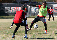 WASHINGTON, DC - NOVEMBER 14, 2012: Nick DeLeon (18) of DC United approaches Lewis Neal (24) during a practice session before the second leg of the Eastern Conference Championship at DC United practice field, in Washington, DC on November 14.