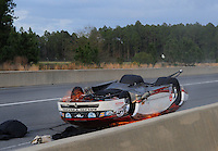 Mar. 9, 2012; Gainesville, FL, USA; NHRA pro mod driver Mike Janis crashes on fire during qualifying for the Gatornationals at Auto Plus Raceway at Gainesville. Janis would be unhurt in the incident. Mandatory Credit: Mark J. Rebilas-