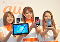 May 15, 2012, Tokyo, Japan - Models show off KDDIs new lineup of mobile phone summer models during a launch in Tokyo on Tuesday, May 15, 2012. The countrys second largest carrier unveiled five new types of smartphone and a tablet computer for the summer season. (Photo by Natsuki Sakai/AFLO) AYF -mis-