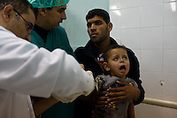 Rafah, Gaza Strip, Jan 12 2009.An Israeli rocket at 7PM in a busy market street in the middle of the city, killed 2 persons  and injured more than 30 others in what appears to be a violation of the Geneva convention on civilian safety by Israel.