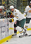 27 January 2012: University of Vermont Catamount defenseman Anders Franzon, a Junior from Plattsburgh, NY, works along the boards during a game against the Northeastern University Huskies at Gutterson Fieldhouse in Burlington, Vermont. The Catamounts fell to the Huskies 8-3 in the first game of their 2-game Hockey East weekend series. Mandatory Credit: Ed Wolfstein Photo
