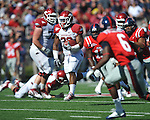 Arkansas running back Dennis Johnson (33) runs against Ole Miss. at Vaught-Hemingway Stadium in Oxford, Miss. on Saturday, October 22, 2011. .