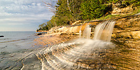 Evening sun lighting up this little waterfall gem as it flows into Lake Superior. Miners Beach, Munising, MI.