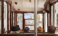 People inside a tram on a steep narrow street in the old town of Lisbon, Portugal. Picture by Manuel Cohen