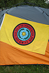 Seal of the Cherokee Nation Flag on side of tent at Thunderbird Pow-Wow, showing ethnic pride, heritage and celebration of Native Americans.  Often people camp out for this three day event.<br /> <br /> Seal of the Cherokee Nation Sept. 6, 1839