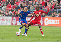 Toronto, Ontario - April 12, 2014:Colorado Rapids midfielder Nick LaBrocca #2 and Toronto FC midfielder Jackson Goncalves #11in action during the 2nd half in a game between the Colorado Rapids and Toronto FC at BMO Field in Toronto.<br /> Colorado Rapids won 1-0.