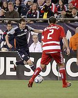 New England Revolution midfielder Marko Perovic (29) prepares to pass the ball to midfield as FC Dallas midfielder/forward Daniel Hernandez (2) prepares to intercept.  The New England Revolution drew FC Dallas 1-1, at Gillette Stadium on May 1, 2010