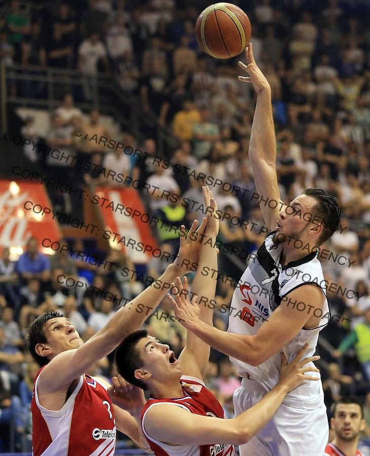 Kosarka play off final game 1 <br /> Partizan v Crvena Zvezda<br /> Joffrey Lauvergne (R) Luka Mitrovic (C) and Boban Marjanovic (L)<br /> Belgrade, 06.15.2014.<br /> foto: Srdjan Stevanovic/Starsportphoto &copy;
