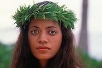 Head shot of a Hawaiian woman with a fern haku lei.