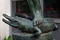 Detail of the statue called Le Chasseur de Crocodiles (Crocodile Hunter), created by Baron Charles-Arthur Bourgeois circa 1883 and located in the Menagerie of Jardin des Plantes, at the Reptile house (galerie des Reptiles) built by Jules Andre from 1870 to 1874, Paris, 5th arrondissement, France. Founded in 1794 by Jacques Henri Bernardin de Saint-Pierre, the Menagerie of Jardin des Plantes became the largest exotic animal collection in Europe in the 19th century and is the second oldest public zoo in the world. Picture by Manuel Cohen