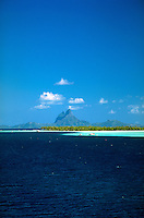 Blue water with mountains of Bora Bora in distance