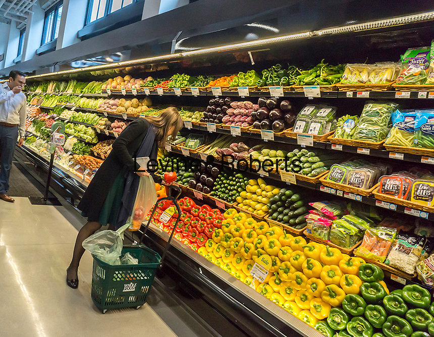 Produce department in the new Whole Foods Market in Newark, NJ on opening day Wednesday, March 1, 2017. The store is the chain's 17th store to open in New Jersey. The 29,000 square foot store located in the redeveloped former Hahne & Co. department store building is seen as a harbinger of the revitalization of Newark which never fully recovered from the riots in the 1960's.  (© Richard B. Levine)